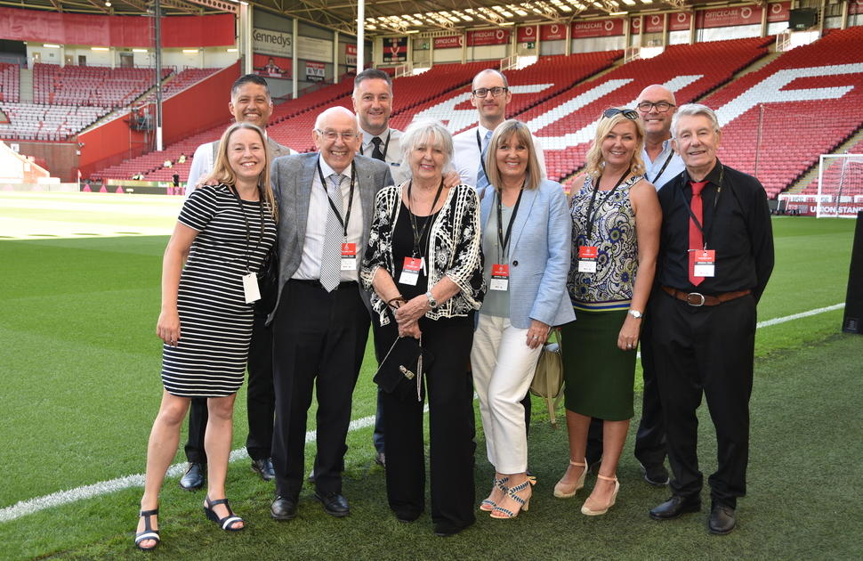 MEPS International senior members of staff standing on the pitch at Bramall Lane
